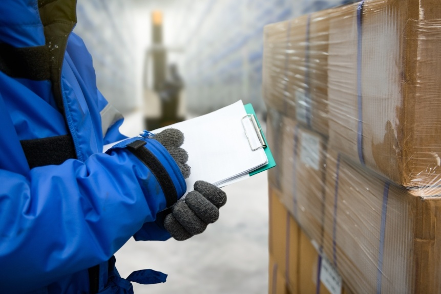 Cold Storage - Man taking inventory in cold storage warehouse